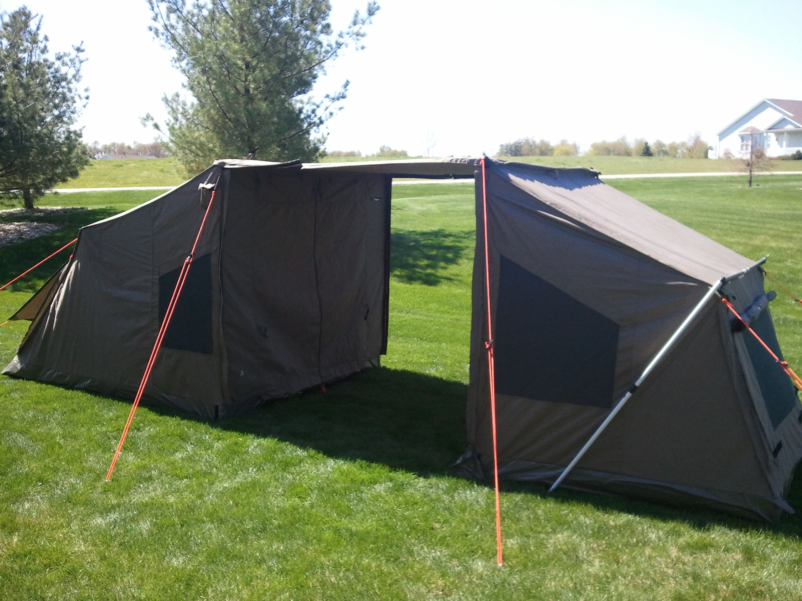 The OzTent Connected By Awning To An Accessory RV4 Tag A Long Tent For