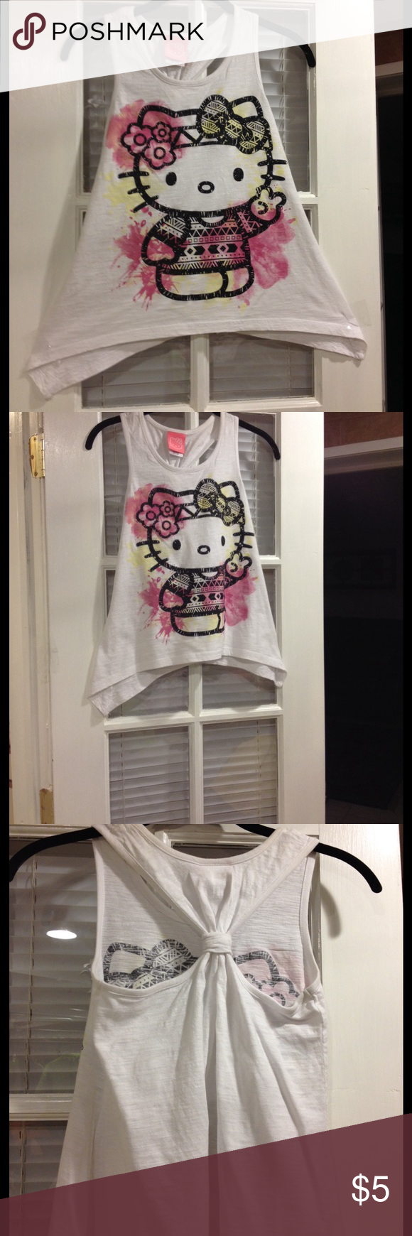 Large (10-12) Hello Kitty top good condition Large (10-12)Hello Kitty top good condition Hello Kitty Shirts & Tops Tank Tops