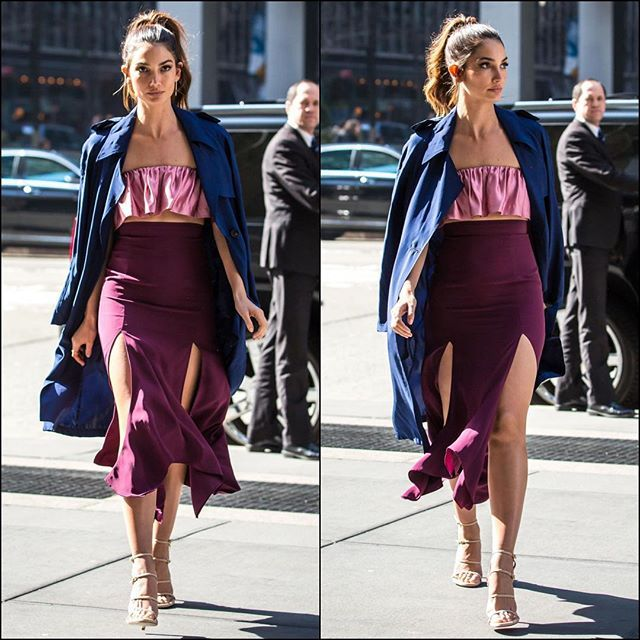 Lily on the streets of NYC in a beautiful satin pink bra-top, skirt and blue trench coat! @lilyaldridge @stuartweitzman #nyc