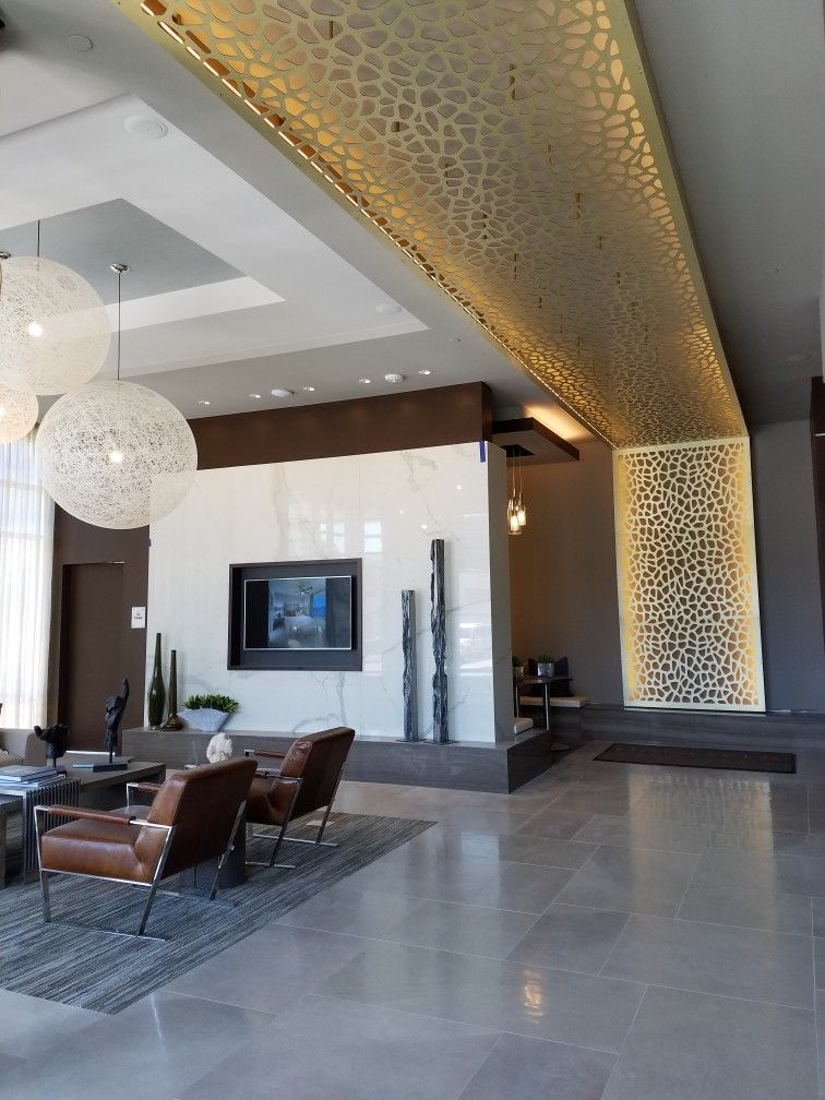 Gold Aluminum Composite Cnc Panels With Back Lit Led Lights Is The Perfect Backdrop For This Lobb Ceiling Design Bedroom Furniture Design Ceiling Design Modern