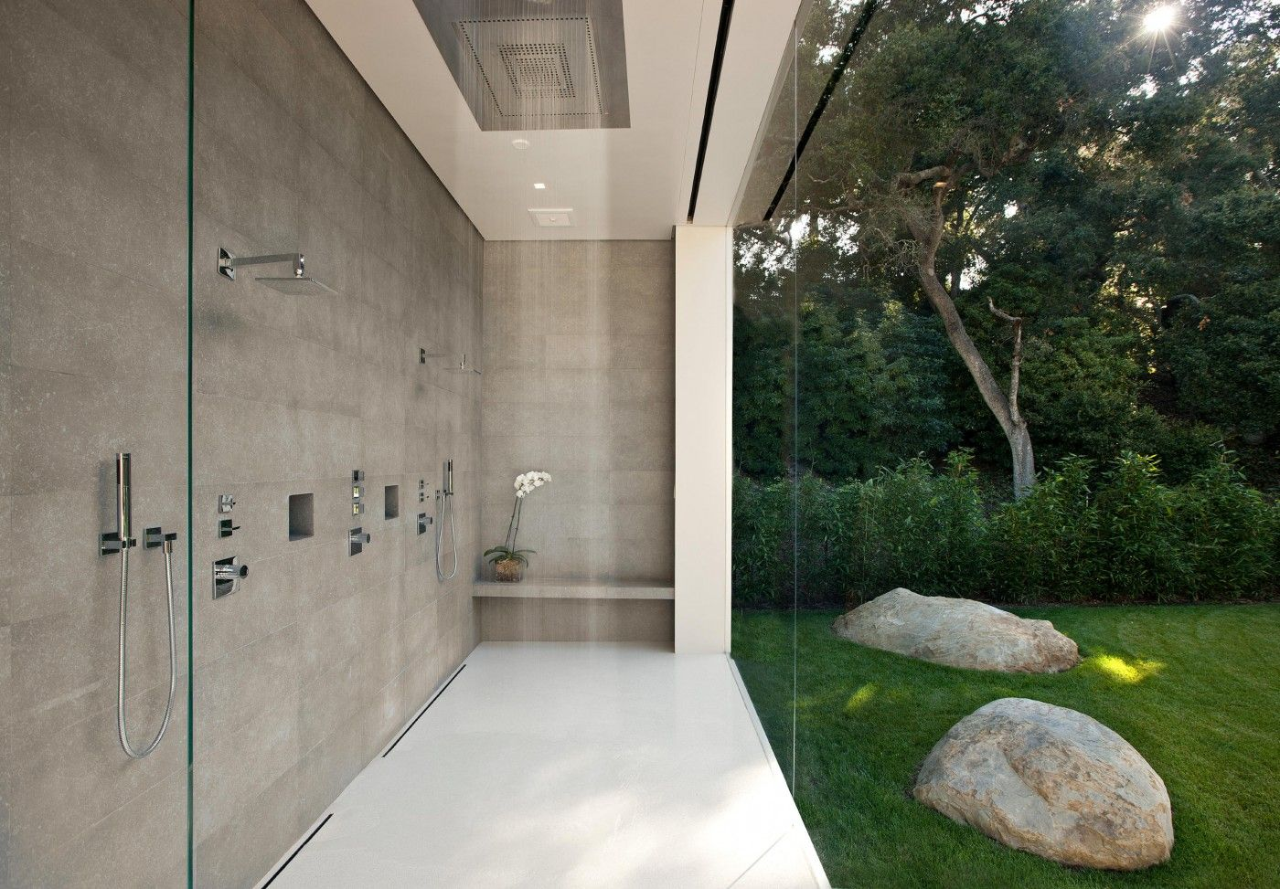 Shower and glass wall in the most minimalist house bathroom