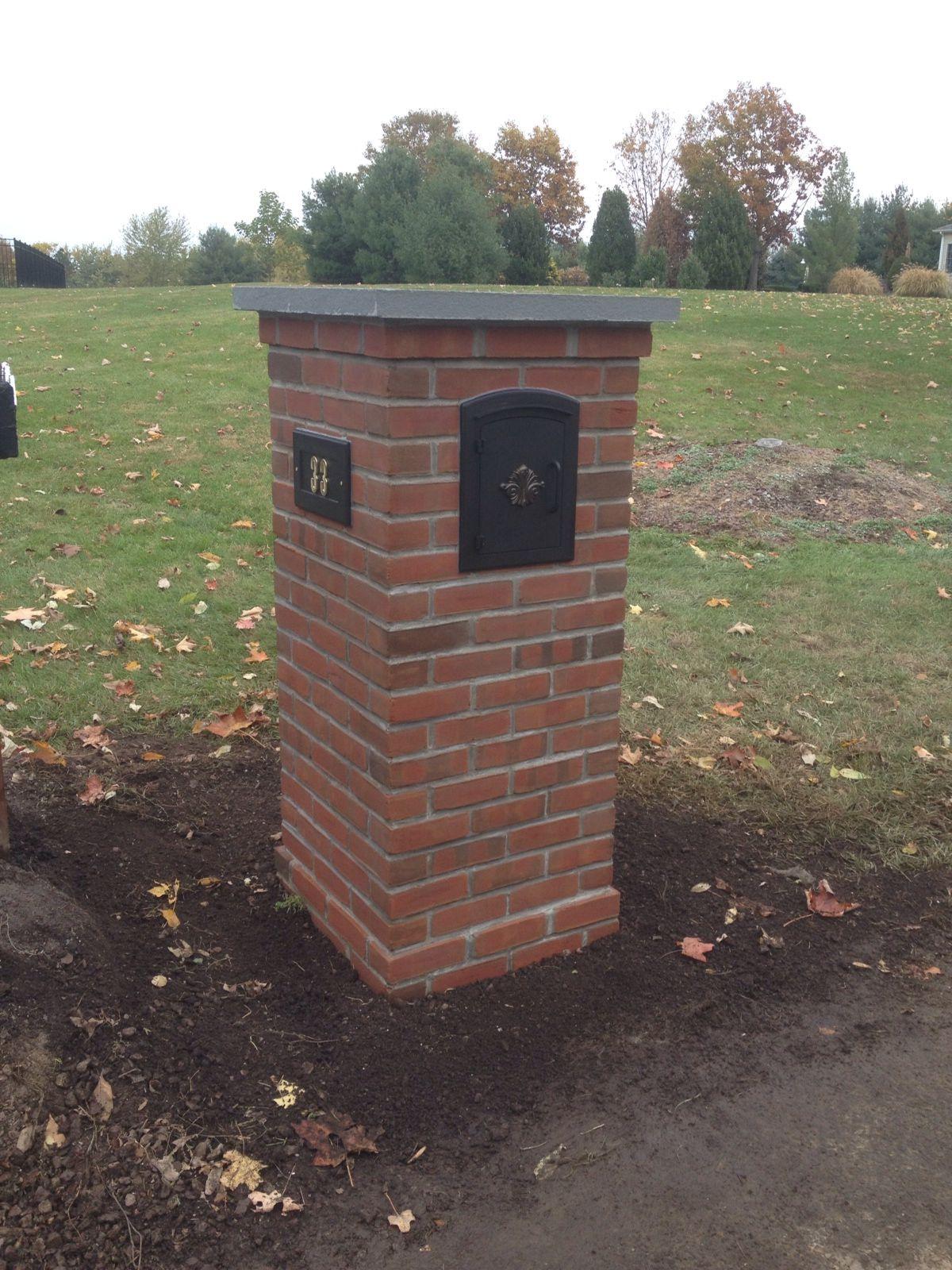 Custom brick mailbox with a bluestone cap