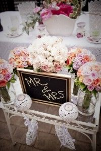 Jars of Water for the bridal bouquets to put in during reception - good idea Kat