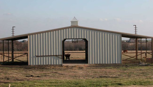 Low budget metal horse barn looks to be under a carport for Cost of building a horse barn