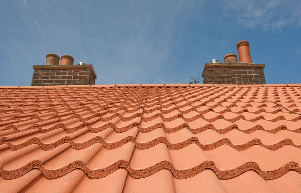 Terracotta Grovebury Roof Tiles. Can be used down to 12.5