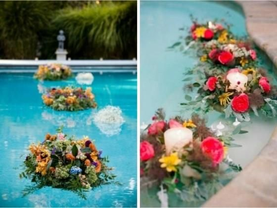 Island of flowers with candles Wedding Decor in the swimming pool ...