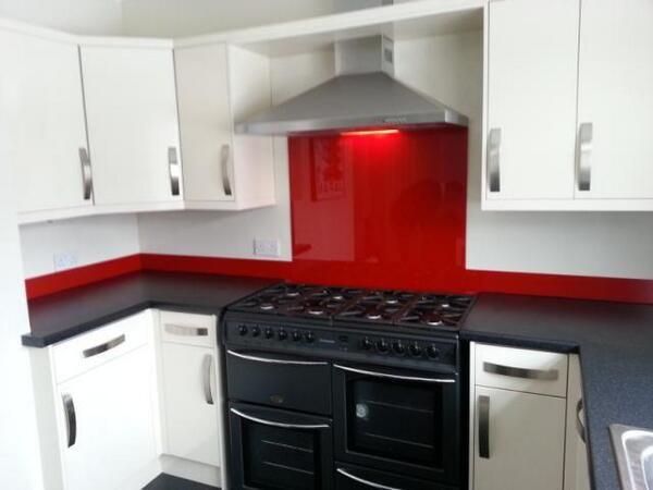 Black And White Kitchen With Red Splashback