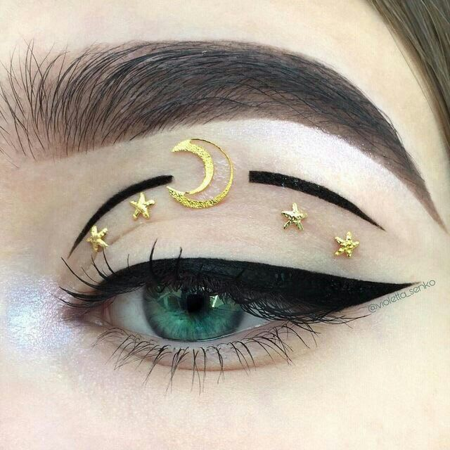Moon Eyes > gold moon and star design > eye makeup art > night festival look