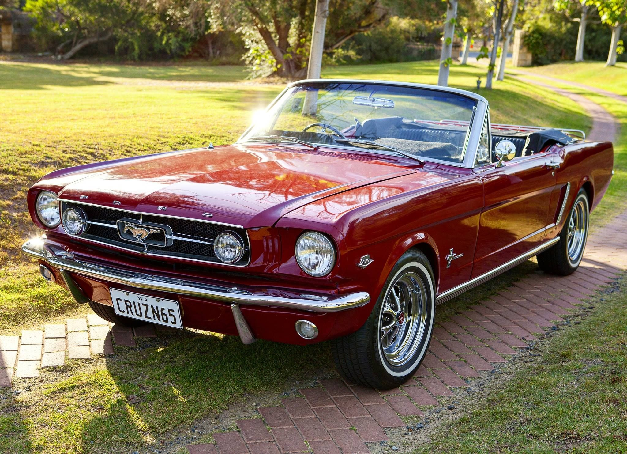 Watts family and their 1965 mustang convertible