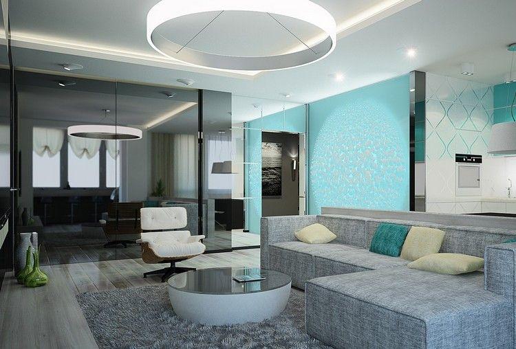 Modernes Wohnzimmer in Grau mit türkisem Farbakzent - wohnzimmer ideen grau turkis