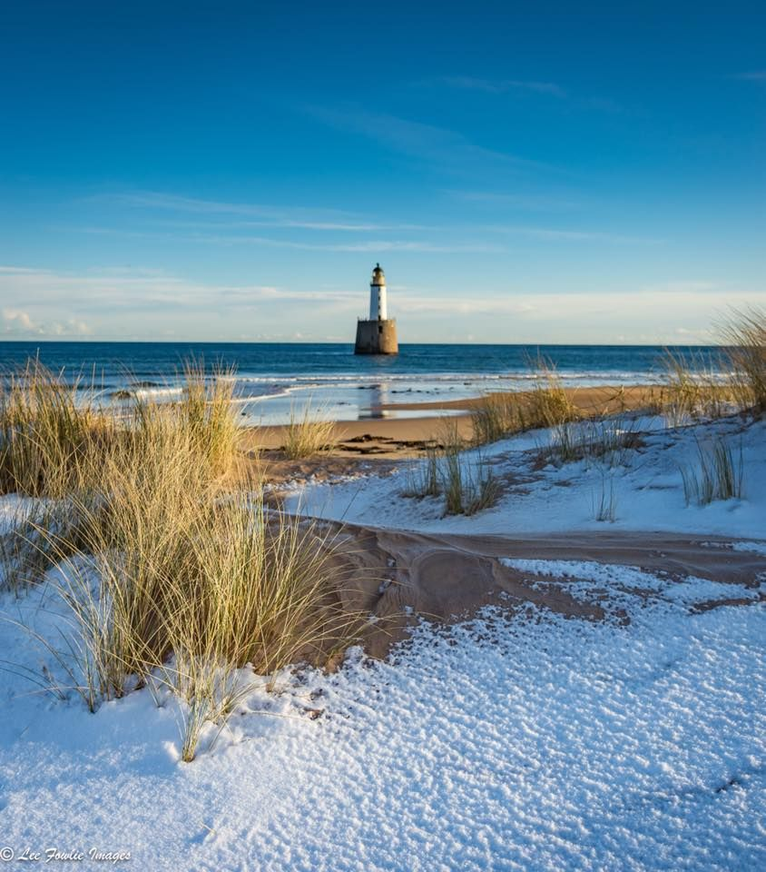 Snow on the beach at Rattray Head Lighthouse, Aberdeenshire
