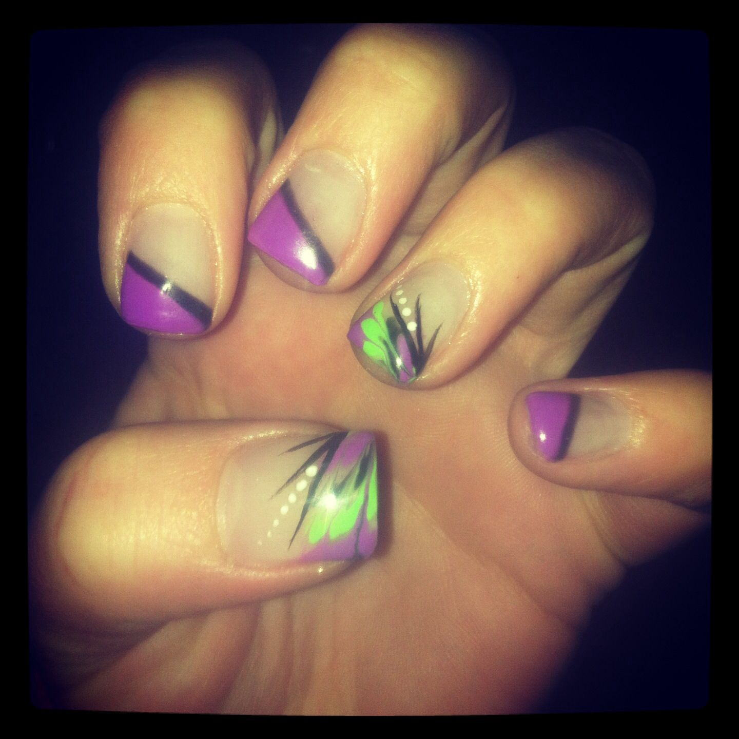 purple and green nails. love