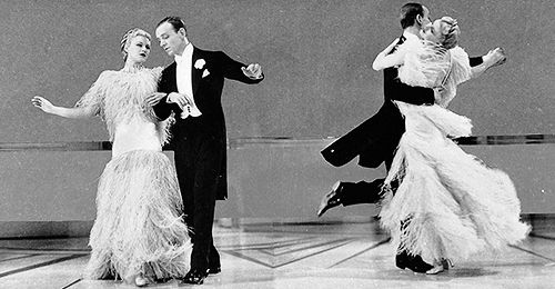 Fred Astaire And Ginger Rogers Dancing Cheek To Cheek In The Film Top Hat 1935