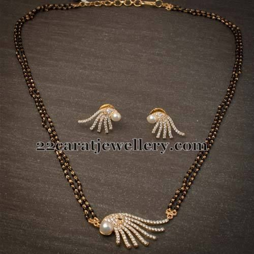 Fancy simple mangalsutra jewellery designs black beads for Simple gold ornaments