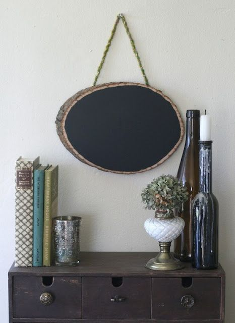 Lovely simple vignette with hanging chalkboard