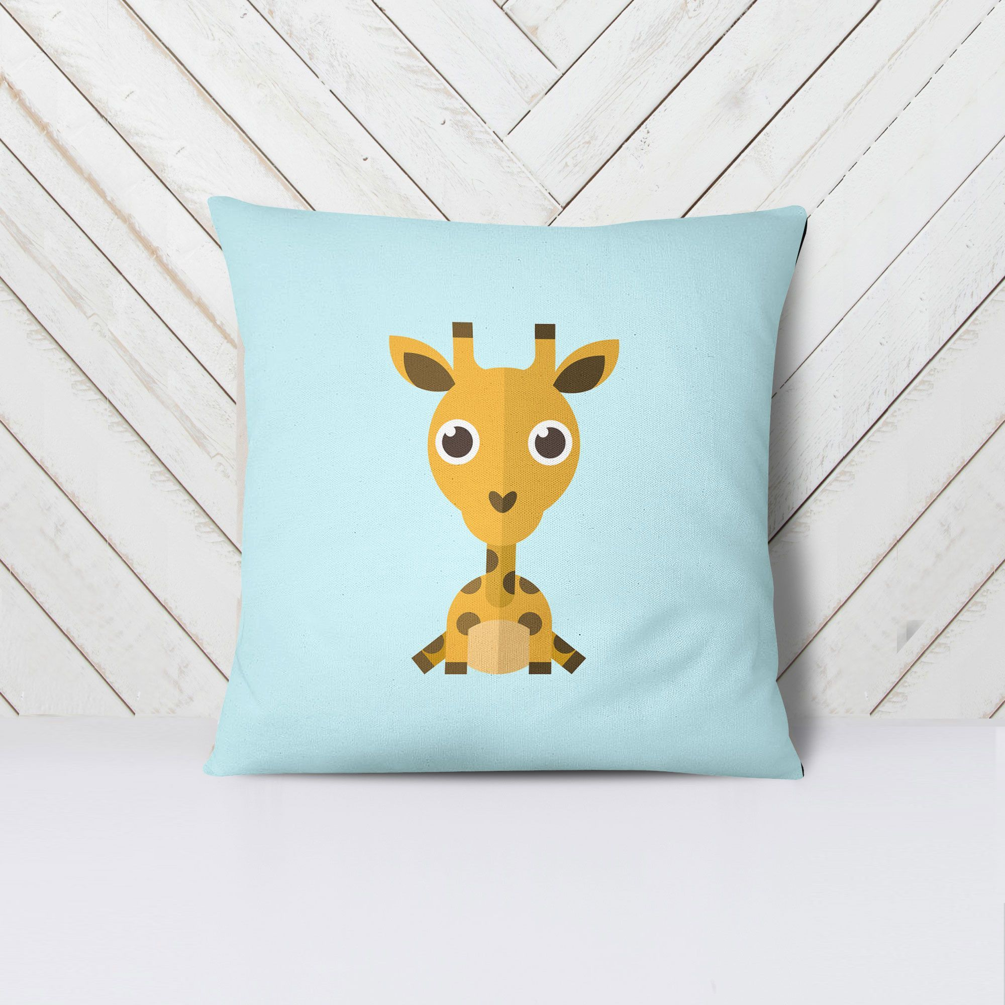 Blue Giraffe - This beautiful and colorful pillow case, complete with the stuffing, is 100% made - cut, sewn and printed - in California. It measures 18x18 inches and it's 80% polyester, 20% cotton fleece. The pillow is machine washable, the pillow insert is hand-wash only.