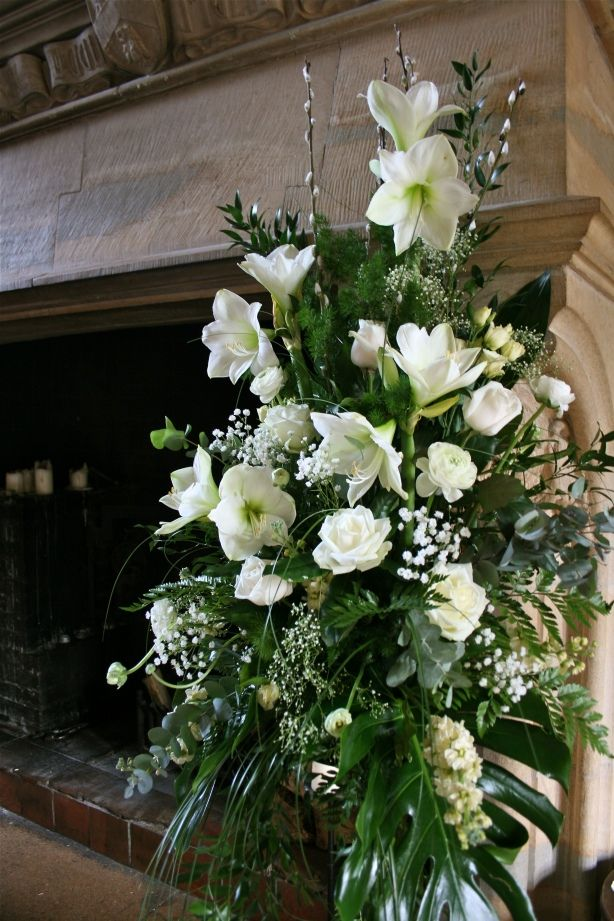 White wedding flower display with spring flowers at