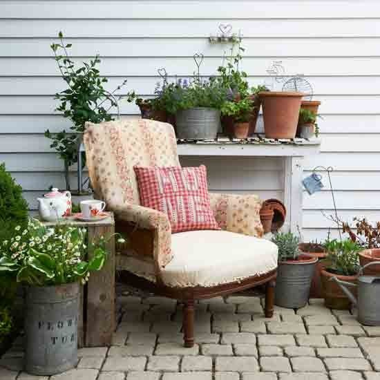 cosy country garden a mix of patchwork rustic planters and vintage touches combine to