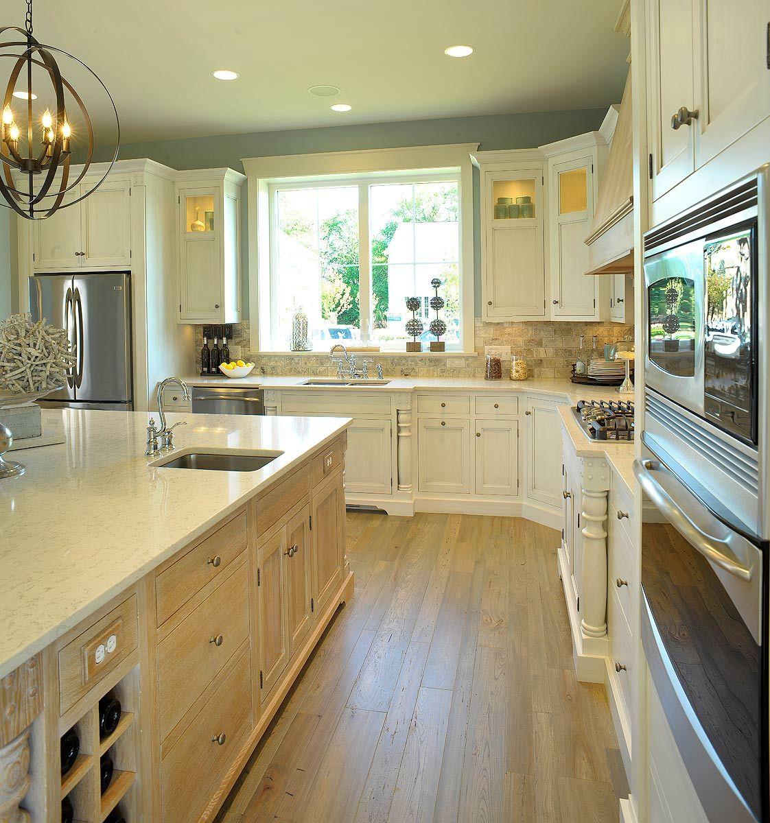 Elegant Whitewashed Kitchen With Quarter