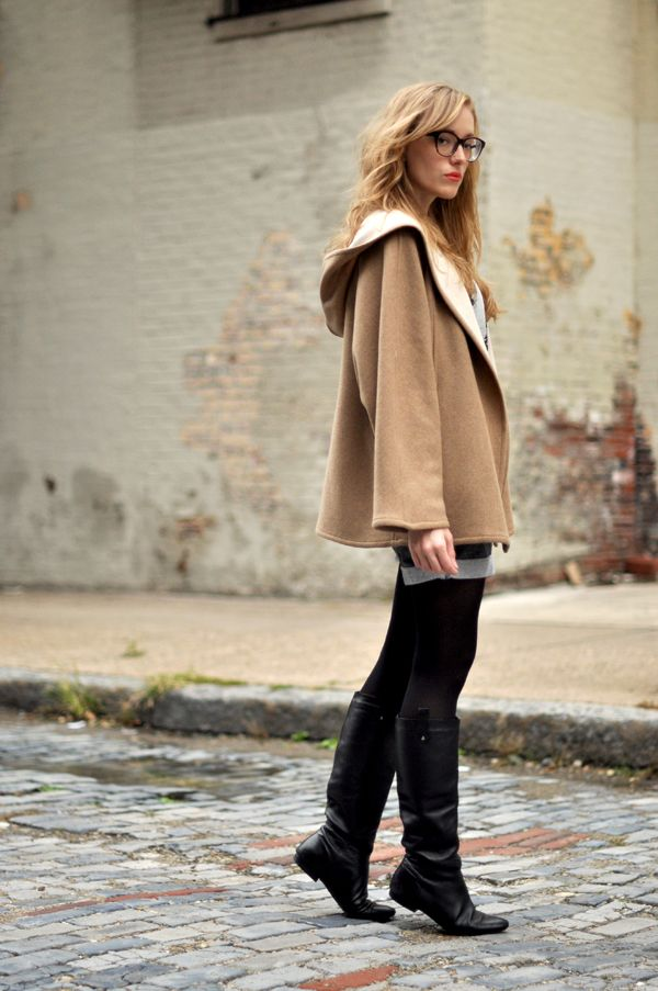 coat. shorts and tights. boots. glasses.