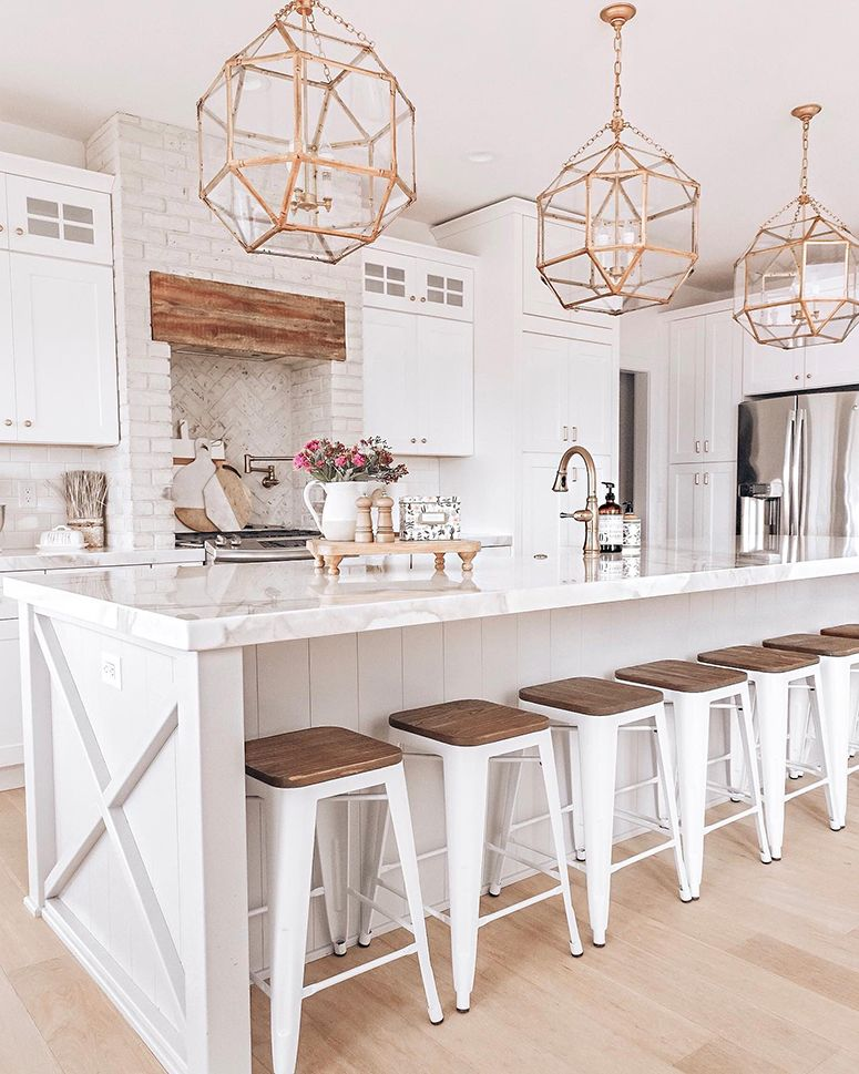 updating kitchen counter stools, brass light fixture, white kitchen | Nina Williams Blog #kitchendesign #kitcheninspo #whitekitchen #kitchen #lightfixtures #kitchenisland