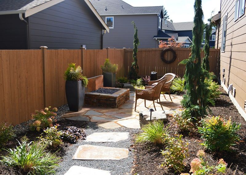 Small Side Yard Flagstone Patio With Natural Gas Fire