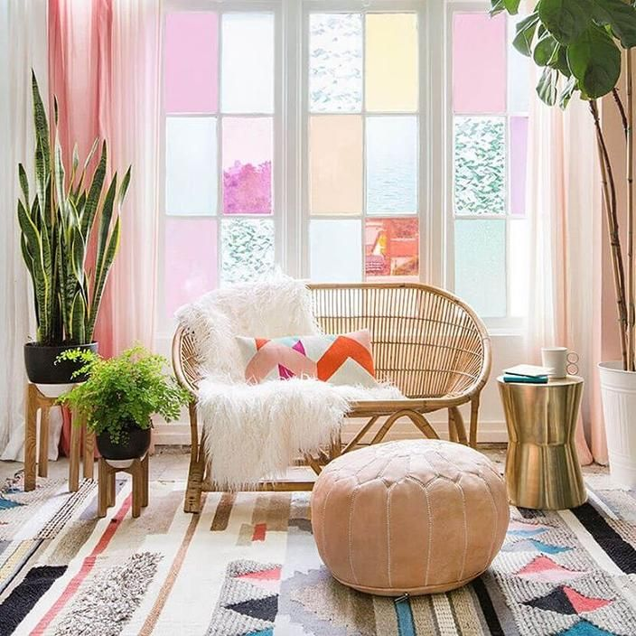 Check out this super fun and bright living room! We love all the colors throughout the room, especially in the window panes. What a great looking space!