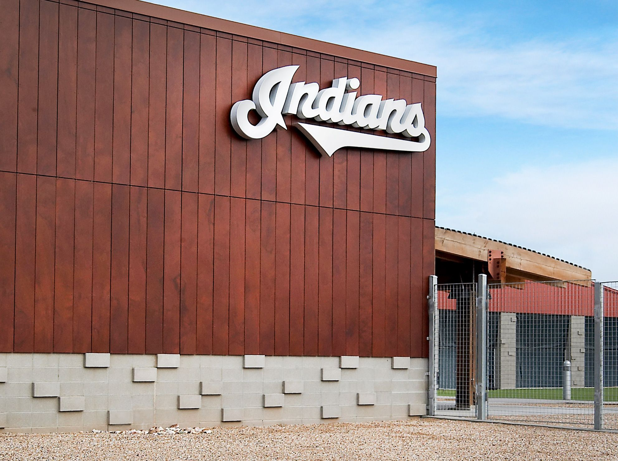 the indians brand is mounted to a synthetic wood veneer panel system