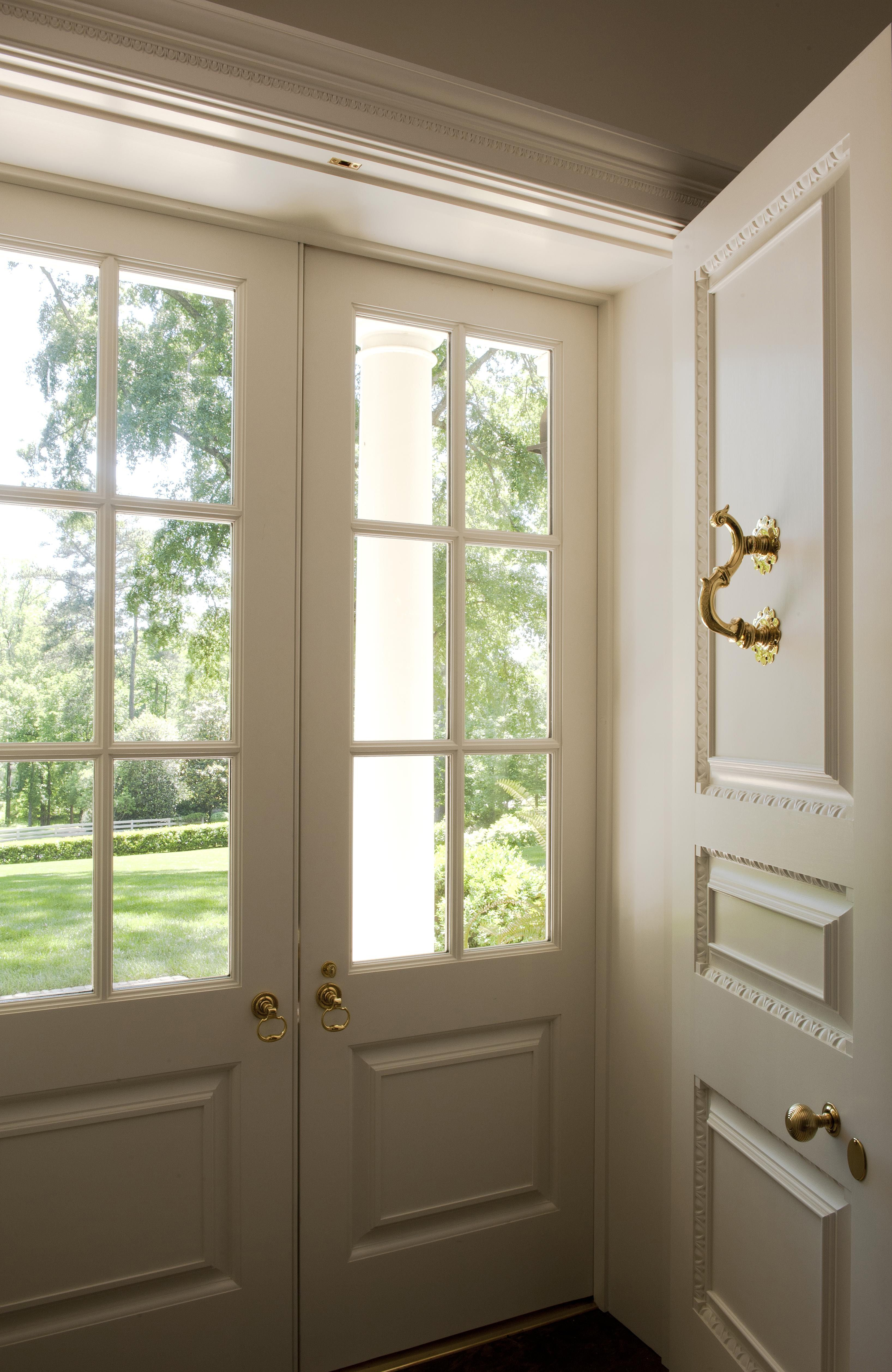 I like having the front door have a glass door in front for Double storm doors for french doors