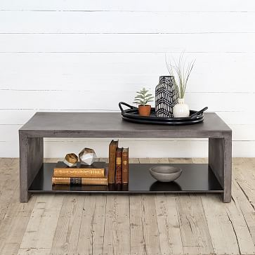 Industrial Concrete Coffee Table is part of Industrial Living Room Concrete - This industrial coffee table's solid concrete top is hand cast, so each surface is subtly unique  An iron shelf provides extra storage for books or games