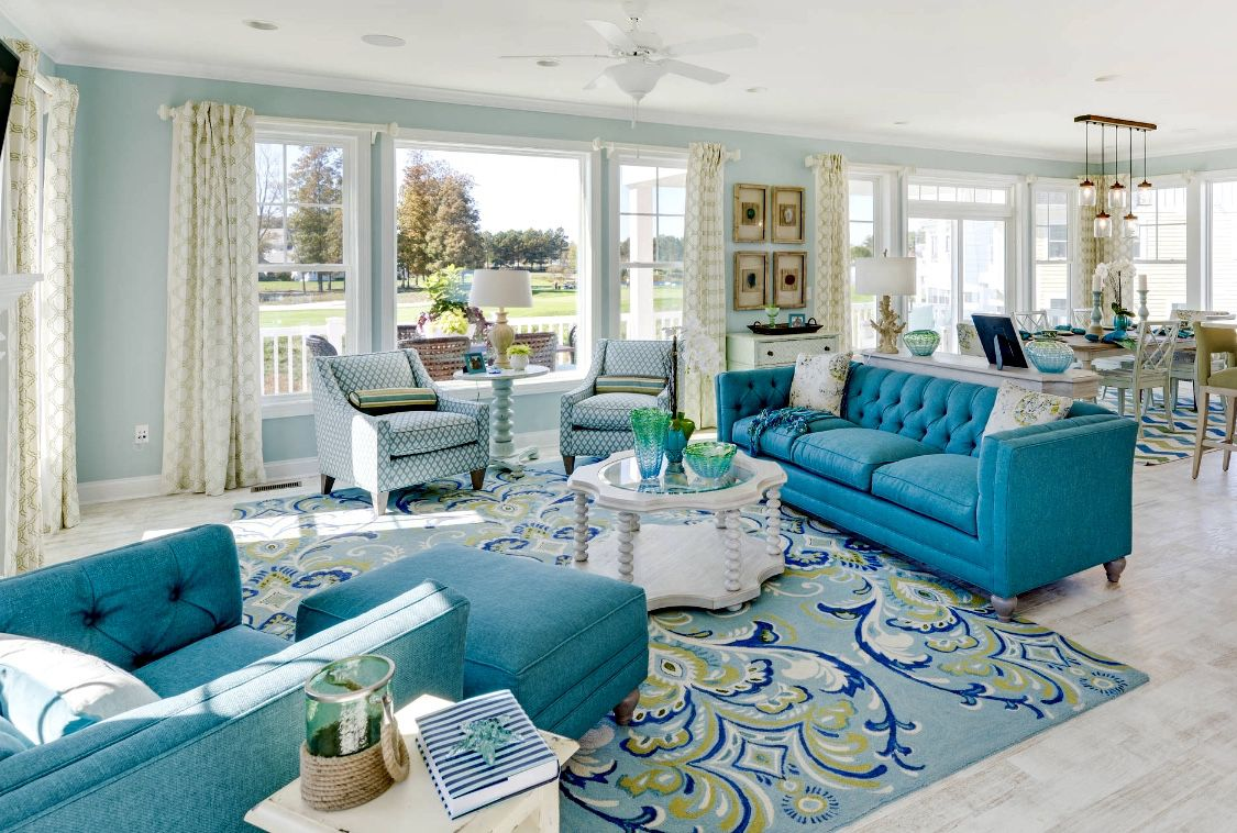 terrific blue turquoise living room   White and blue turquoise living room with blue tufted sofa ...