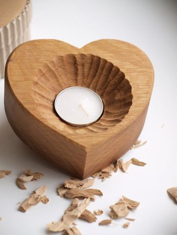 wooden candlestick in the shape of heart dug by hand with …