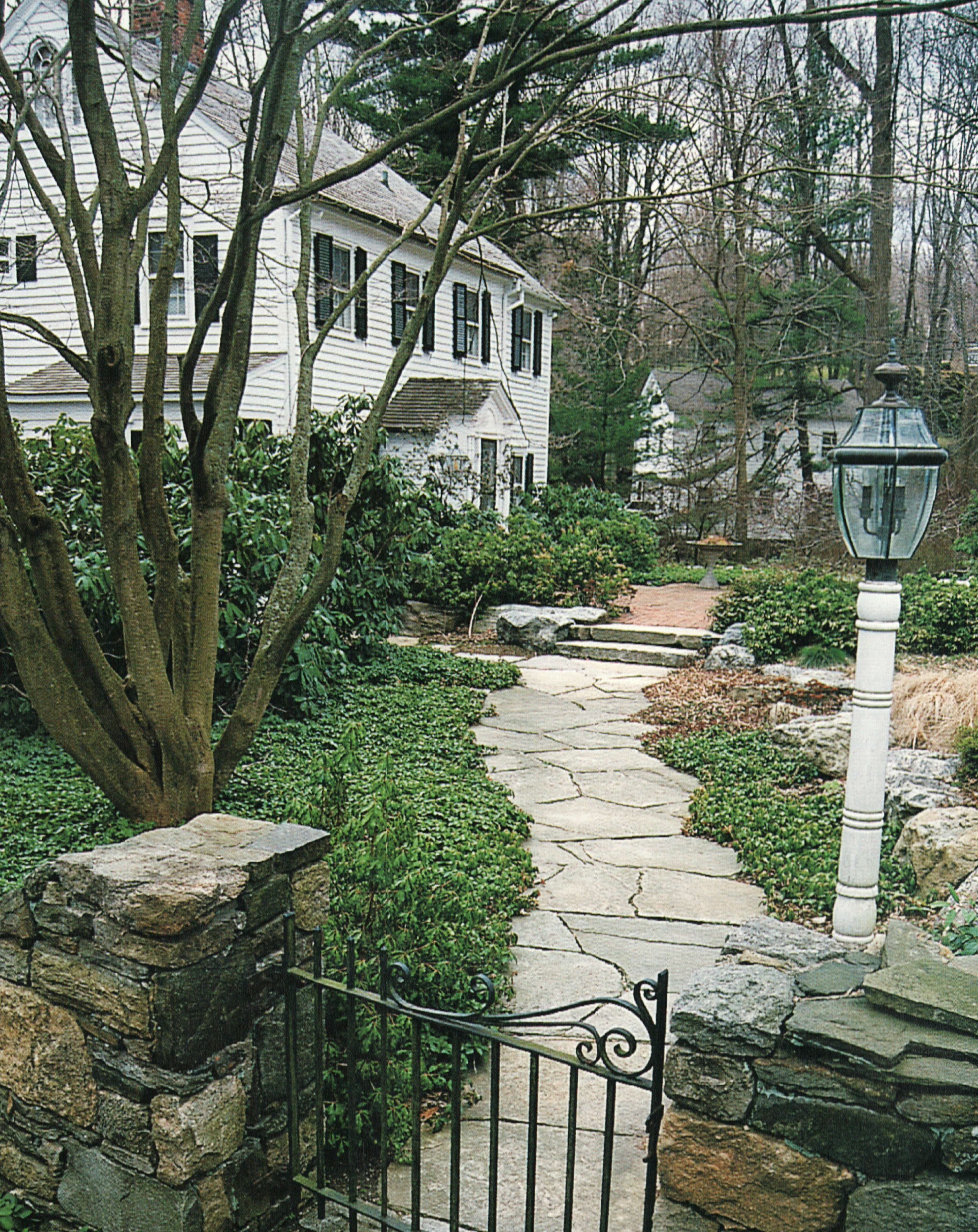 The use of pachysandra or other ground cover along the edges comple ...
