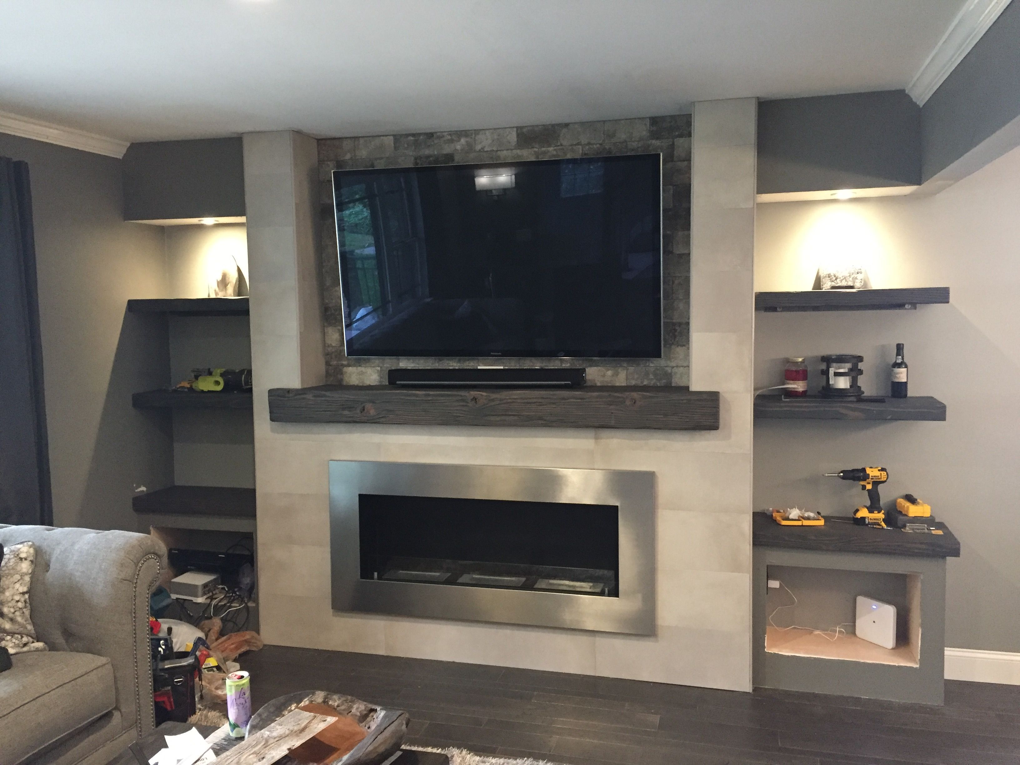 carbon grey mantel with matching shelves in niche homes