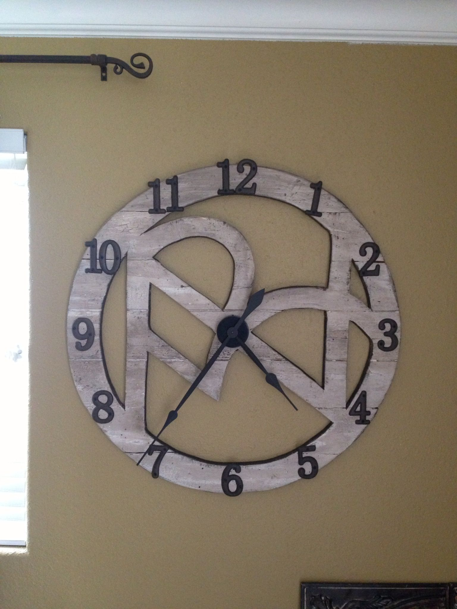 Clock made by my husband out of pallet wood pieces. The design was created by his grandfather in the '50's to brand cattle. It spells our last name.