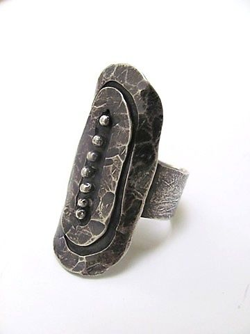 Silver Shield Ring by Lauren Passenti: Silver Ring available at www.artfulhome.com One of a Kind This unique sterling silver shield ring is oxidized to bring out the rich hammer textures. The ring is lightweight and easy to wear as an everyday, go-to piece. Available in size 7.25.