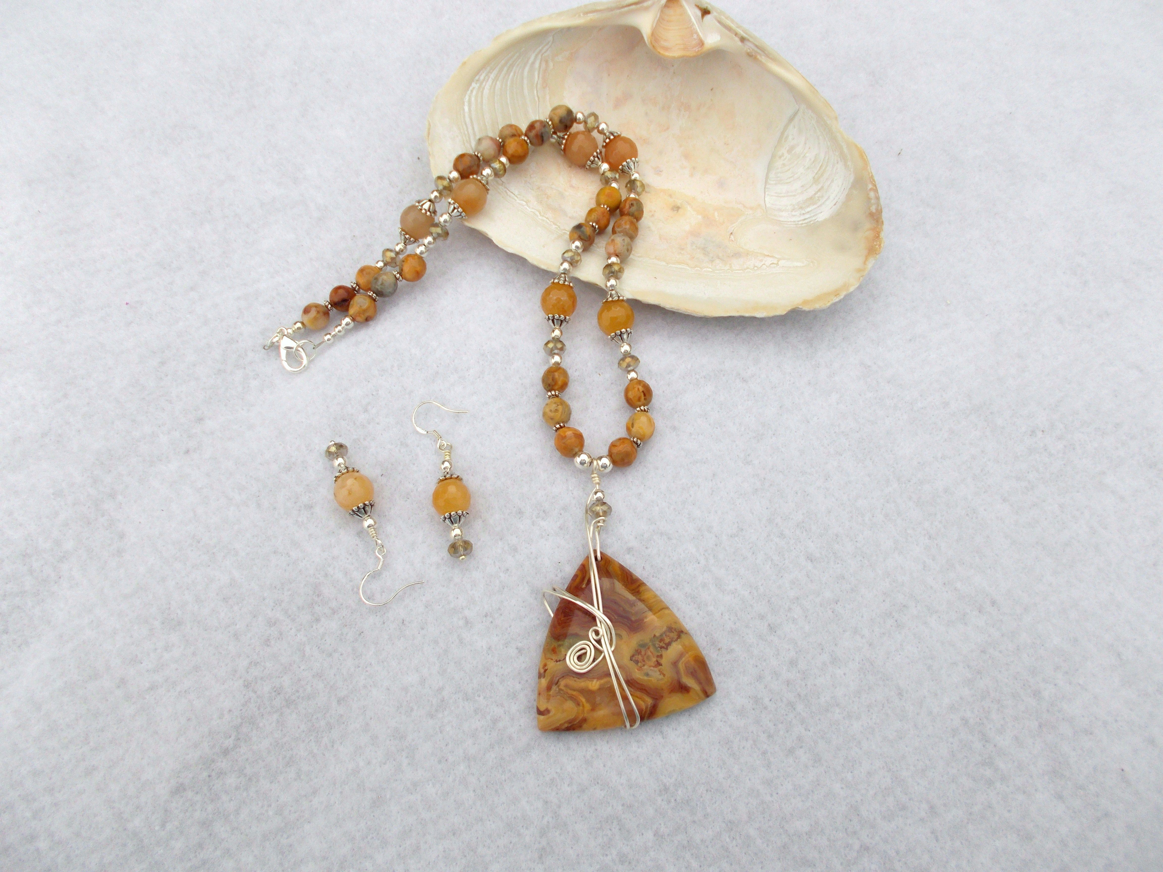 Wire wrapped crazy lace agate pendant necklace and earrings. Sold