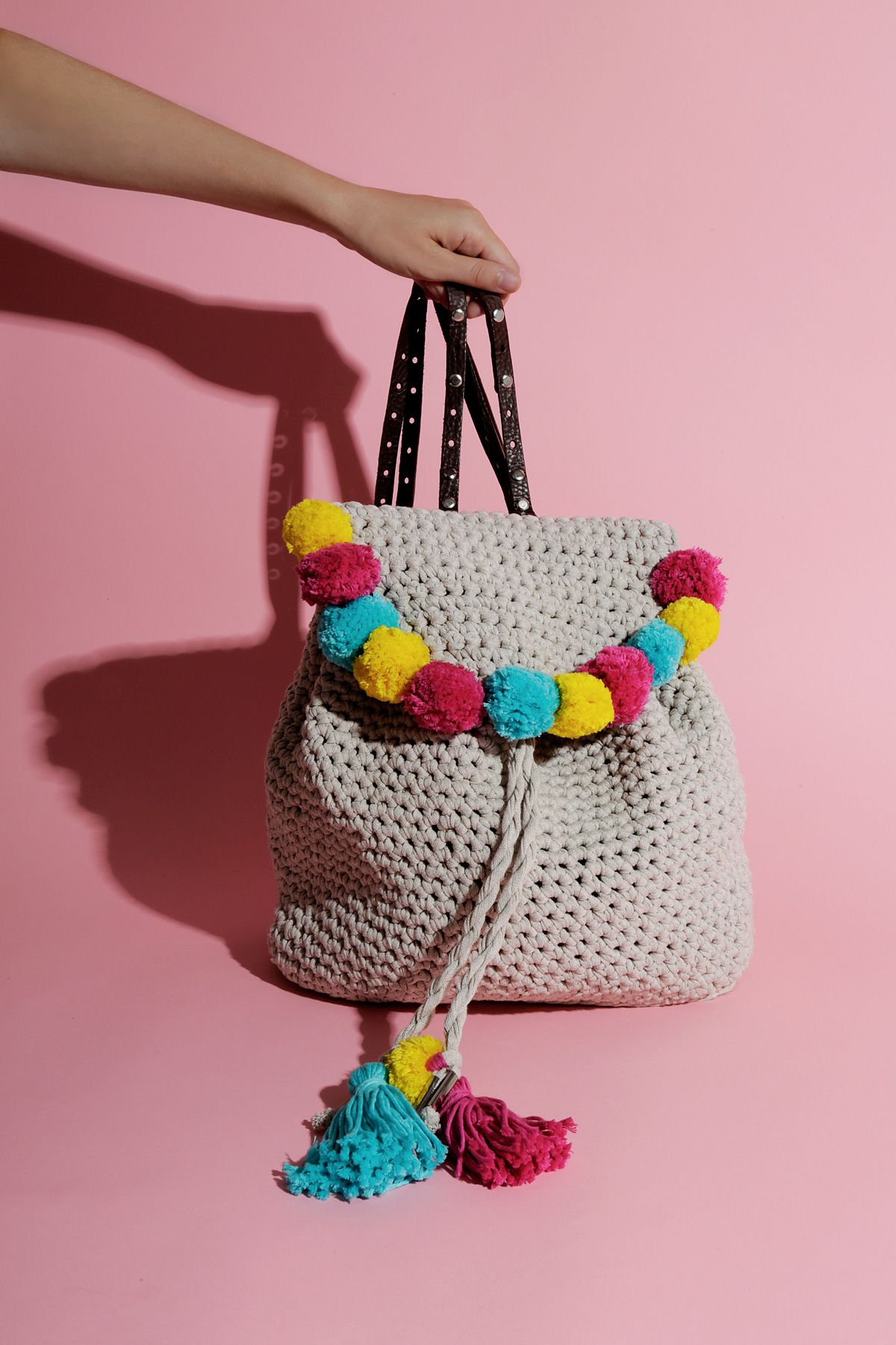 Such a cute crochet backpack with pom poms and tassels on! A great ...