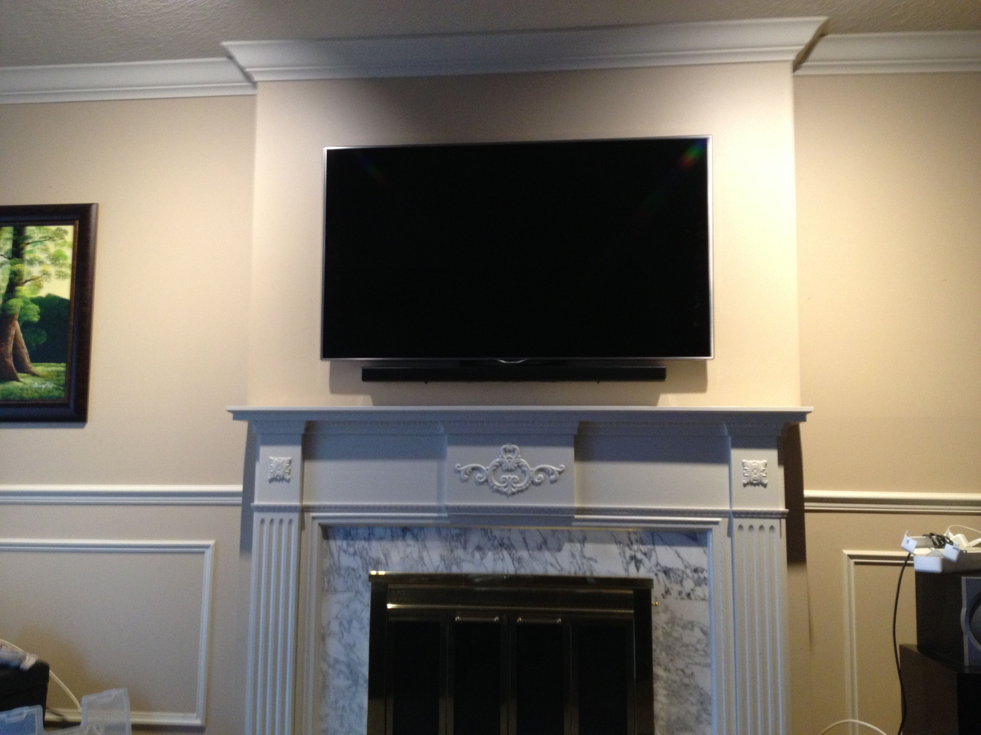 Sound Bar Installed Below The Tv Using Sound Bar Brackets Attached