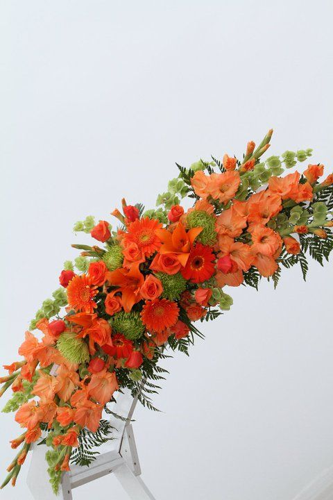 Wedding Arch With Orange And Lime Green Fresh Flowers