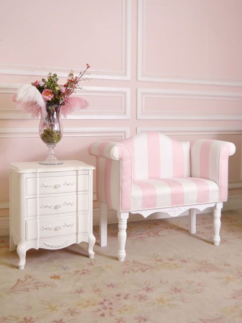 Pink decor and wall color give this room a feminine feel.  We love the how the white trim gives the room architectural detail.