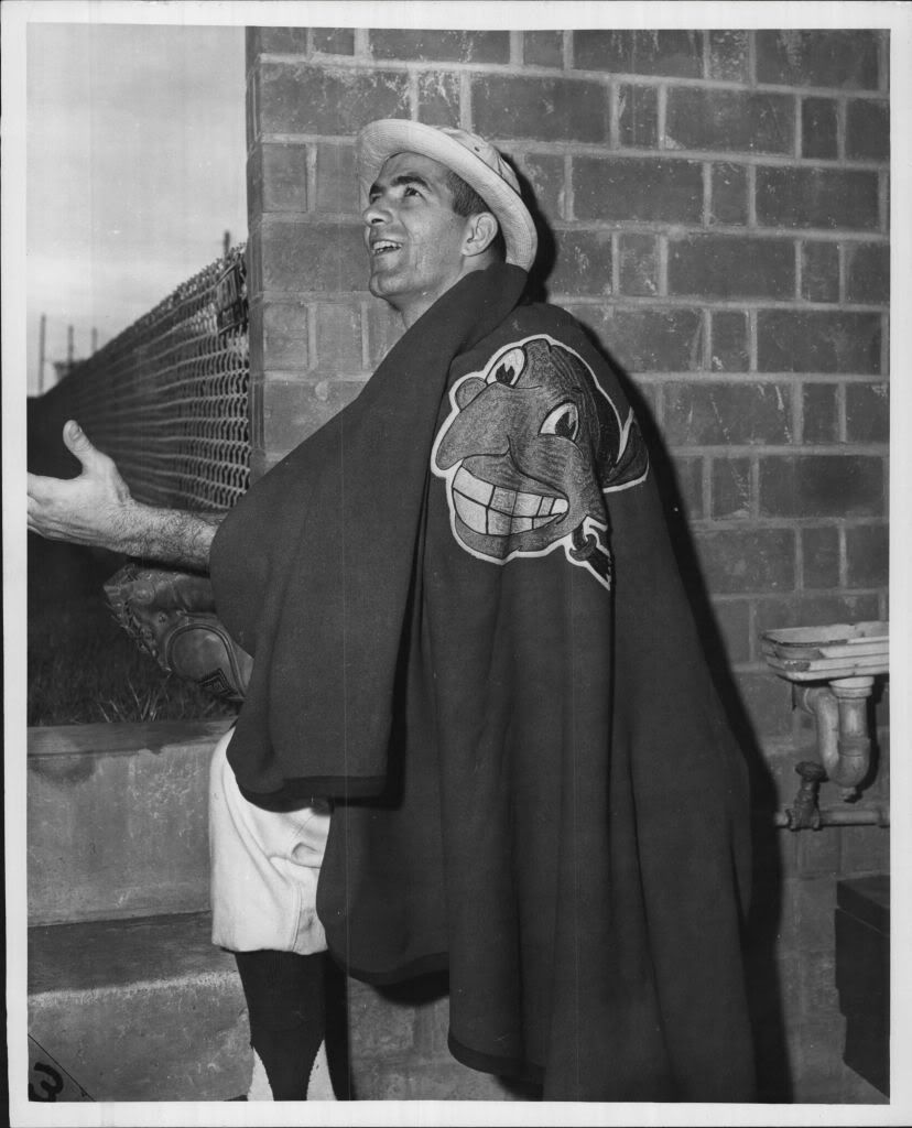 Joe Altobelli, Rocky's teammate in Reading and in Cleveland, keeping warm with a Chief Wahoo stadium blanket.