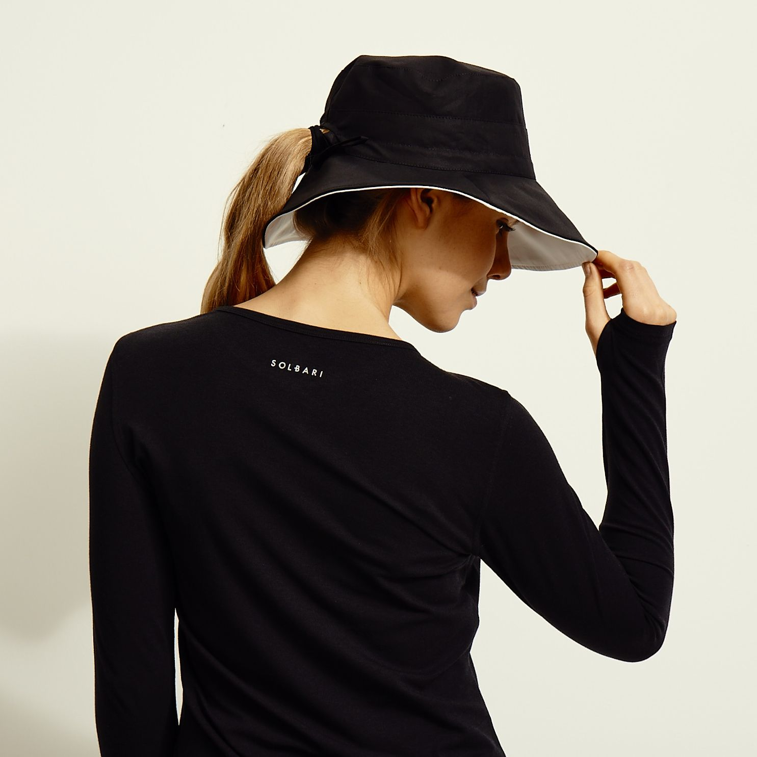 bc9697c2411 One of SOLBARI s best sellers... Our black and white reversible wide brim sun  hat for ladies. It is elegant