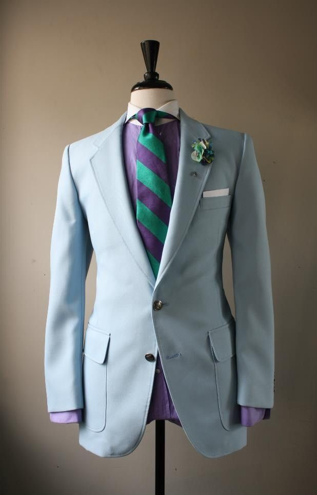 light blue suit with purple and teal accents him