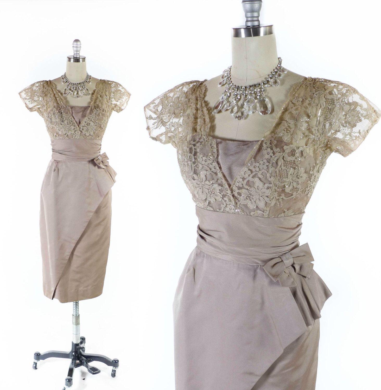 "Vintage 50s Dress // 1950s Dress // Formal Dress // Cocktail Dress // Asymmetrical Dress // Peplum Dress - sz XS - 24"" Waist by SwellFarewell on Etsy https://www.etsy.com/listing/245602378/vintage-50s-dress-1950s-dress-formal"