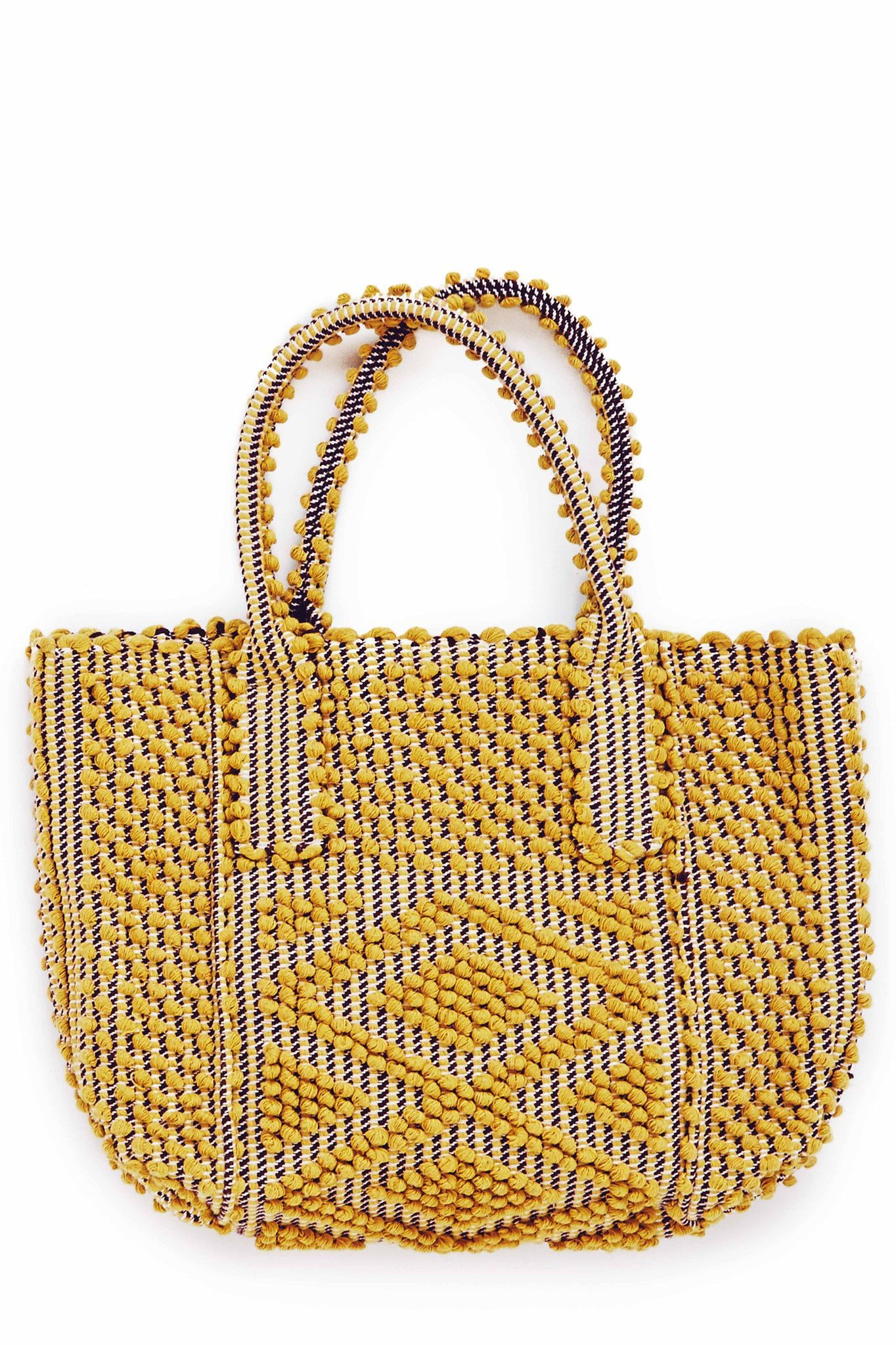 Antonello Tedde is a luxury, eco-conscious handbag collection designed in London and hand-crafted in Sardinia, Italy. The styles are produced in limited numbers and handwoven on looms using recycled a