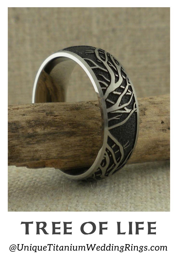 Domed Titanium Wedding Ring With Tree Of Life Branches Black Background Unique Titanium Wedding Rings In 2020 Black Wedding Rings Titanium Wedding Rings Mens Wedding Rings Black