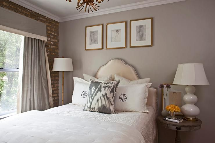 Chic Grey Bedroom Features A Warm Grey Wall Lined With Abstract Nude Sketches In Gold Picture