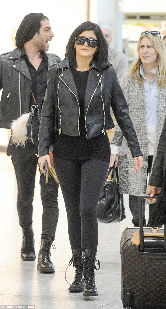 Edgy look: Kylie Jenner was wearing an all-black outfit on Sunday as she arrived at Heathrow Airport in London to catch a flight back to Los Angeles
