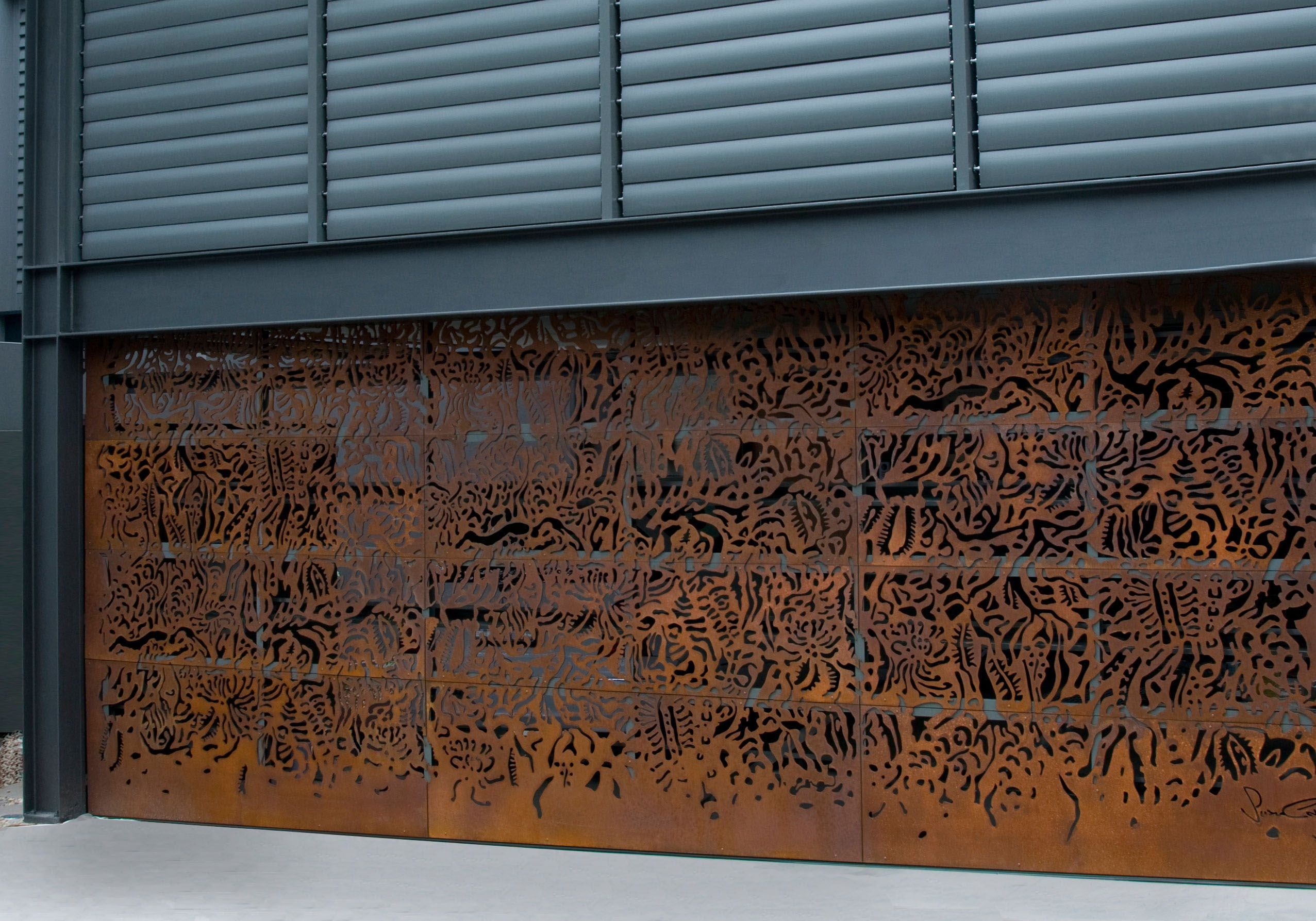 axolotl metal garage door rust router cut design susan designer garage doors from graham day doors